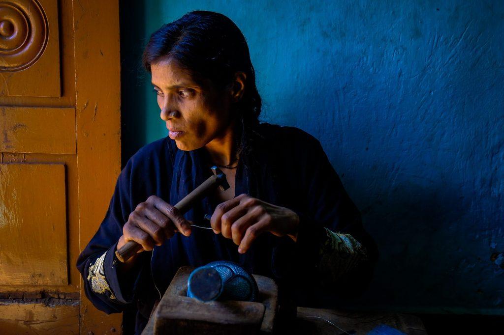 An artisan busy in making Bidriware