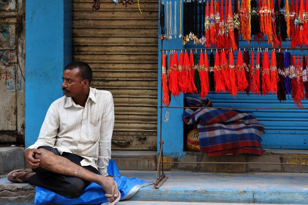 A road-side seller is seen as he waits for his customers.