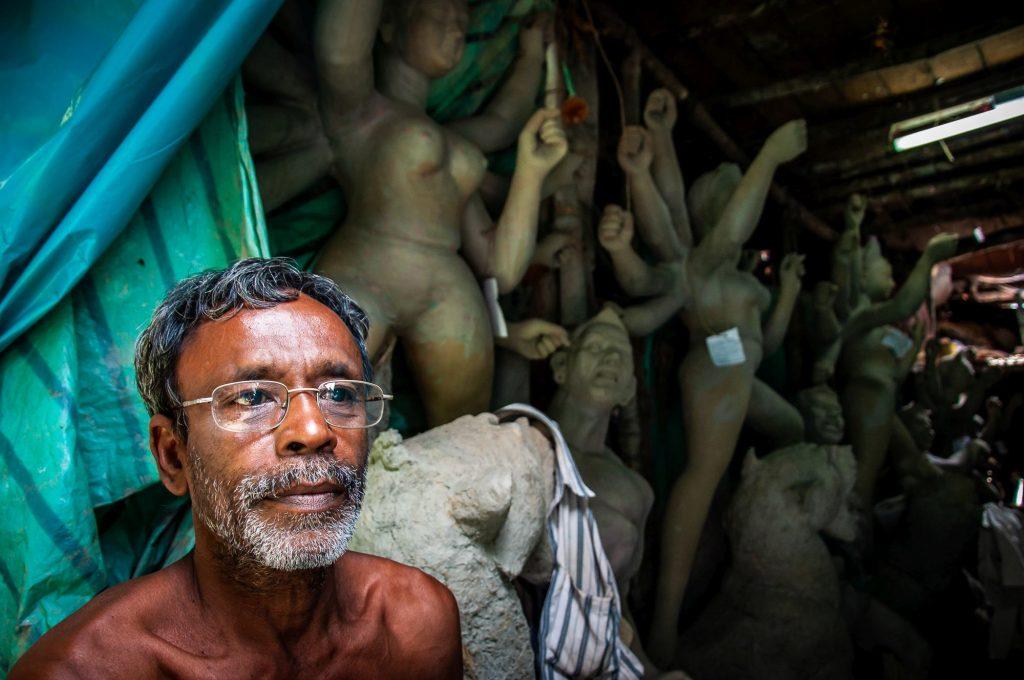 An artisan sitting outside his studio at Kumartuli, Kolkata