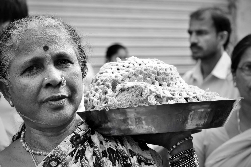 An old lady holds the offerings during the 3rd day of Bonalu festival.