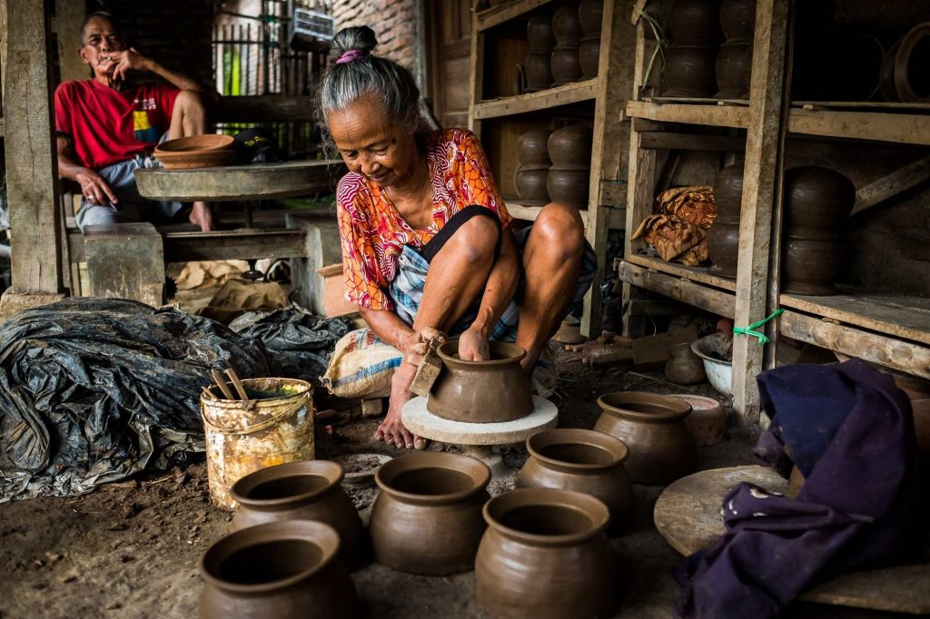 An old lady making pots at home, Indonesia