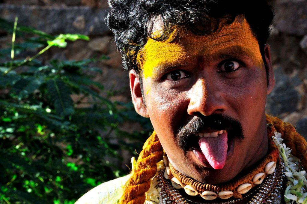 """This person adorns the role of the """"Potharaju"""", the brother of the Goddess, who is believed to be the protector of the village and the initiator of the Bonalu festival."""
