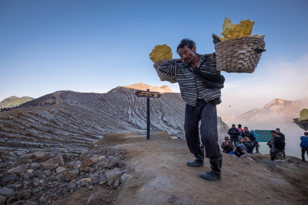 A sulfur miner carrying sulfur from the Ijen Lake, Indonesia