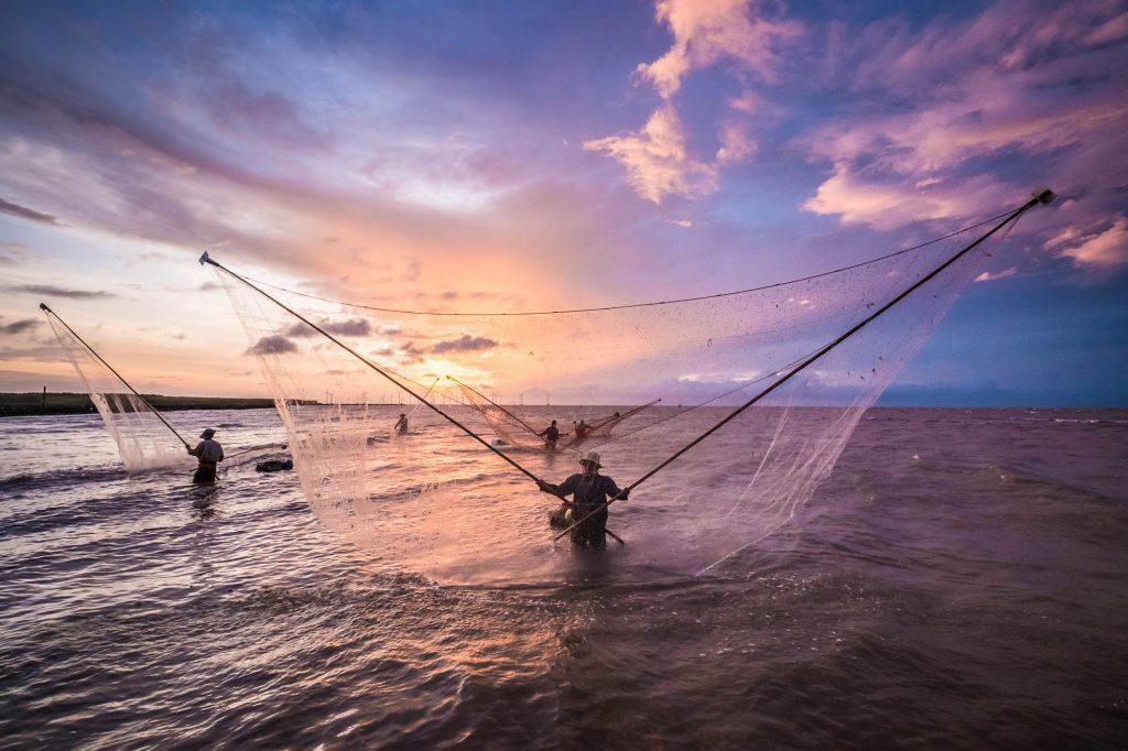 Fishermen catching fish in the sea, Vietnam