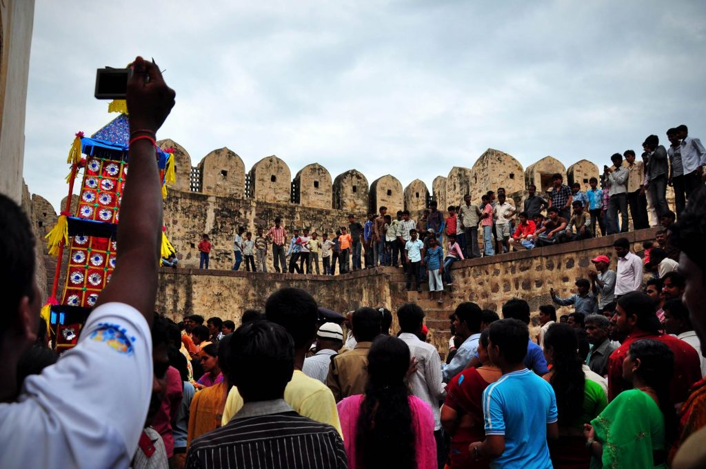 The crowd waiting to watch the procession during the first day of Bonalu festival in Golconda Fort in Hyderabad.