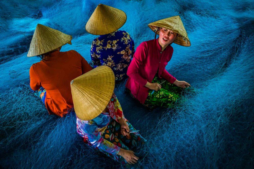 Lady workers working at a net mending factory near Bac Lieu, Vietnam