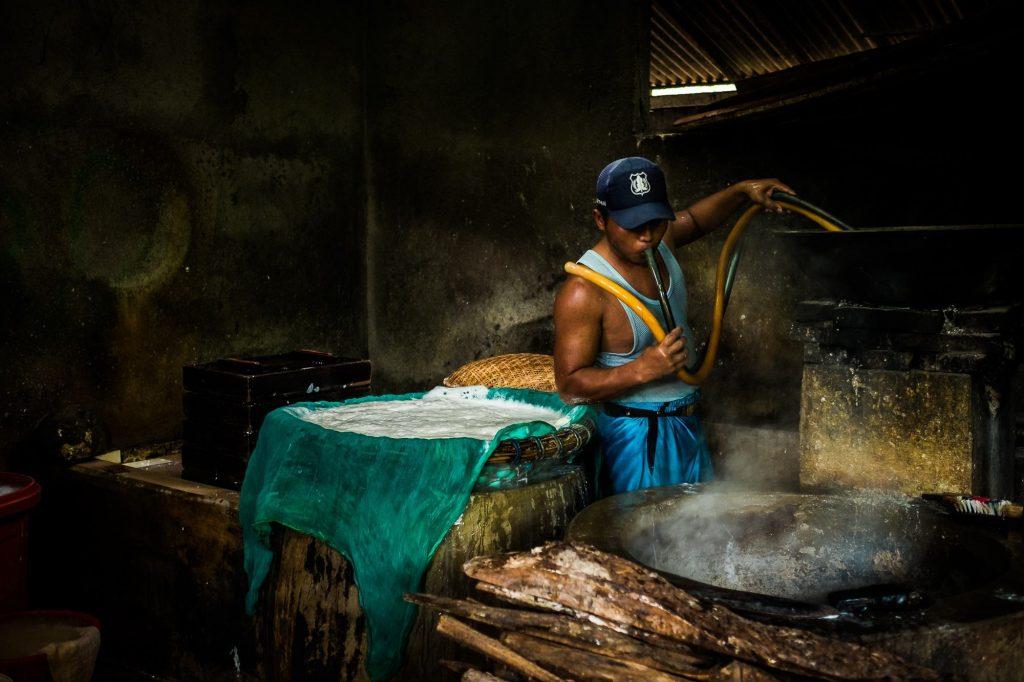 Worker working at tofu factory at Tanjung Sari, Indonesia