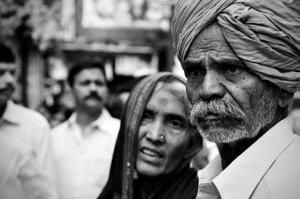 An aged couple waits for a glimpse of the Goddess during the 3rd day of Bonalu festival.