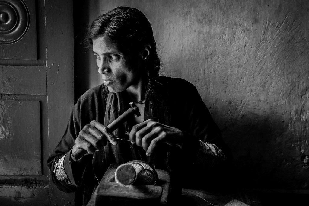 An artisan busy in engraving the Bidriware