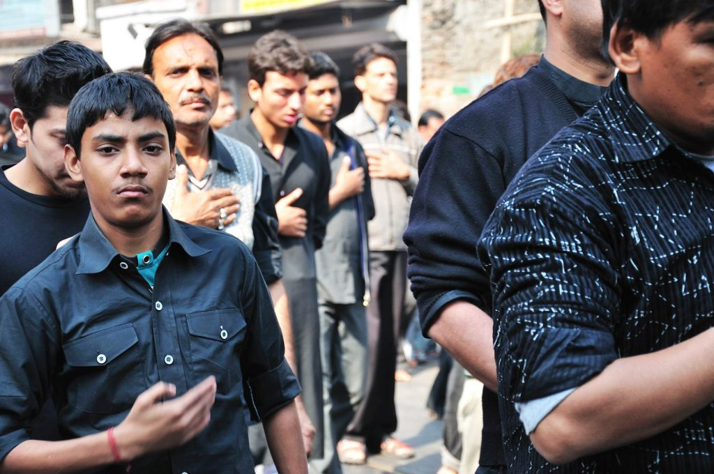 """Shia Muslims Shia Muslims consider this a day of sorrow. In a frenzy of grief, they chant """"Ya Hussain"""", wailing loudly and beating their chests."""