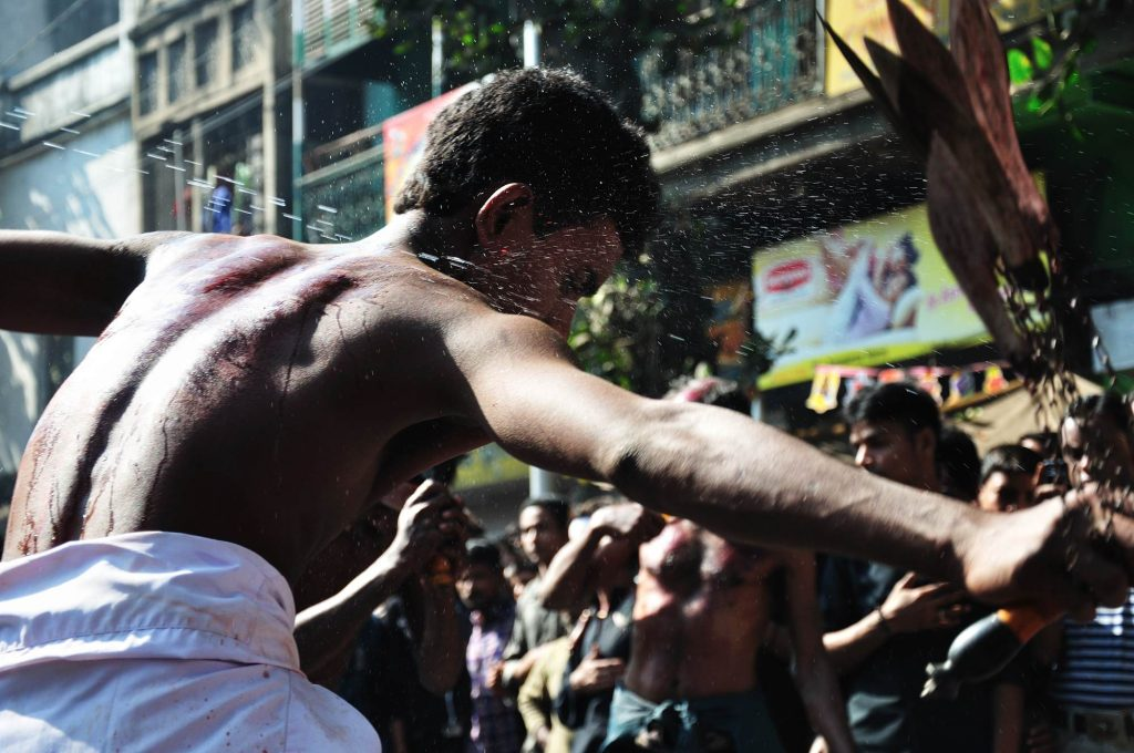Rose-water being sprayed on the wounds caused by the constant hitting with the knives.