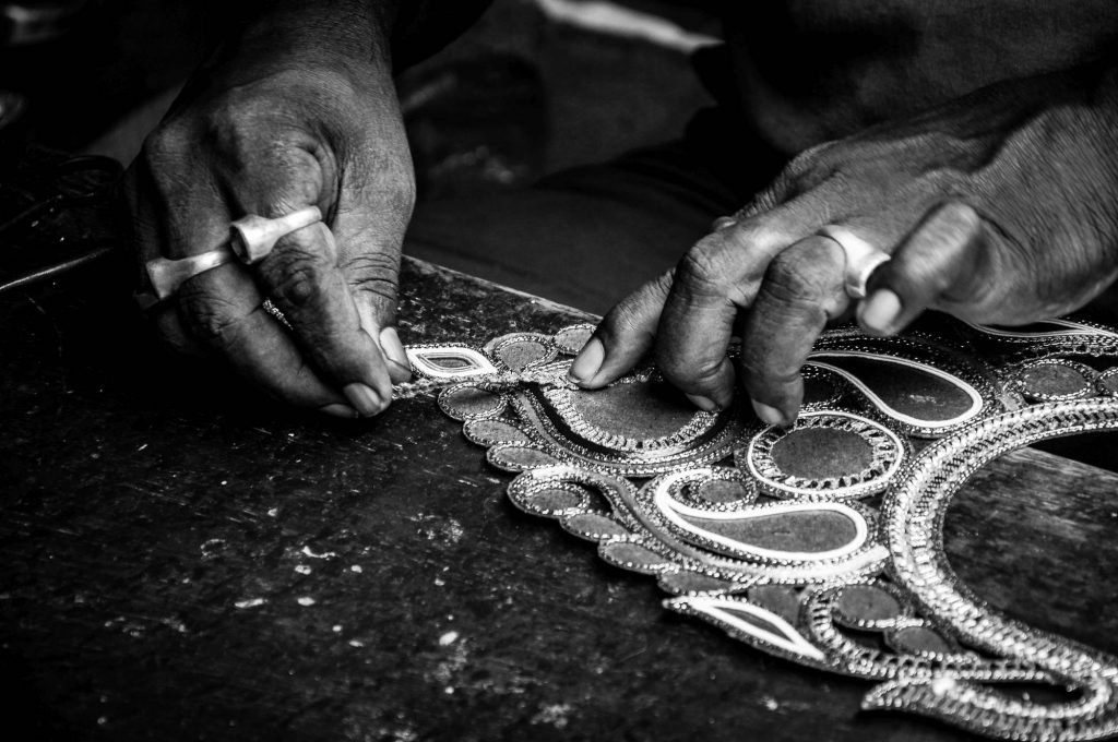 An artisan decorates the props to be used on the idols