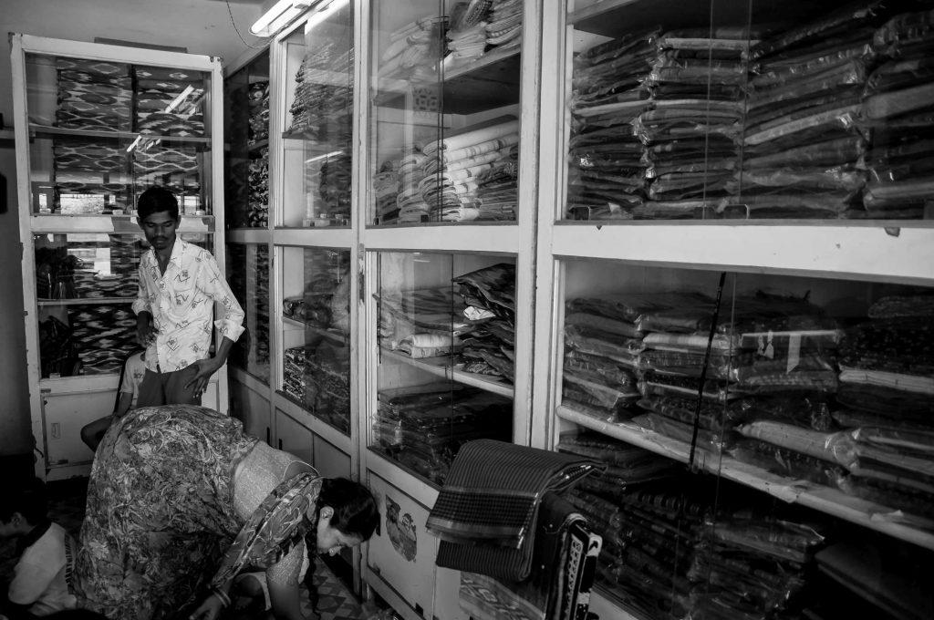 A family runs a saree shop at their home