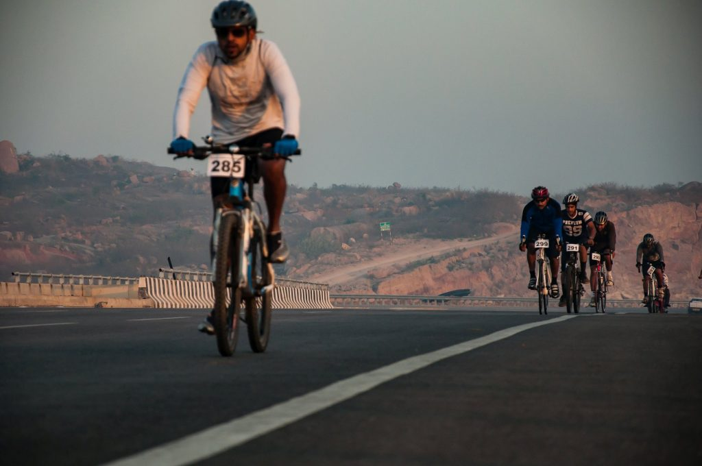Cyclists ride the 40 km long bicycle competition in Nehru Outer Ring Road.
