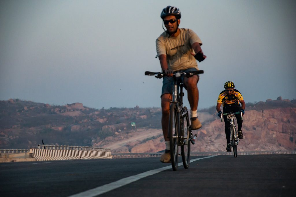 Two participants cycle during the race.