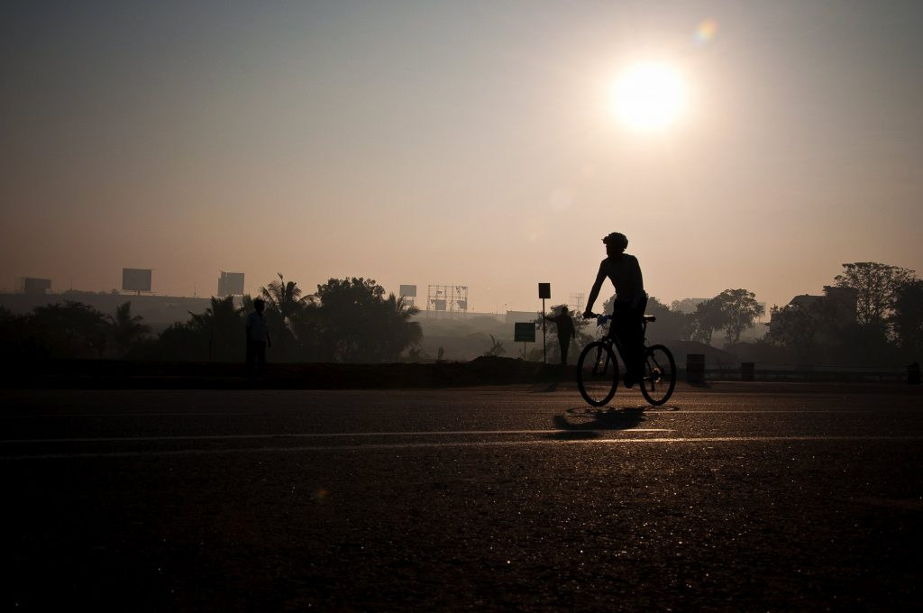 The silhouette of a participant is seen as he rides during the race.