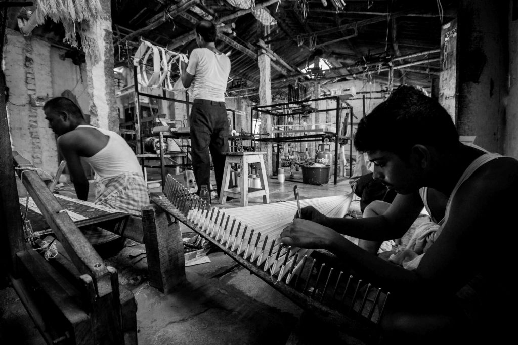 Workers are busy working in a workshop in Pochampally